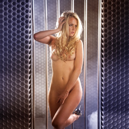 beautiful nude woman locked in a steel prison cell Stock Photo - 10765742