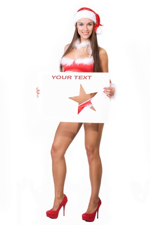 very sexy christmas girl holding empty white board in her hands on wich you can write your text on Stock Photo - 11277338