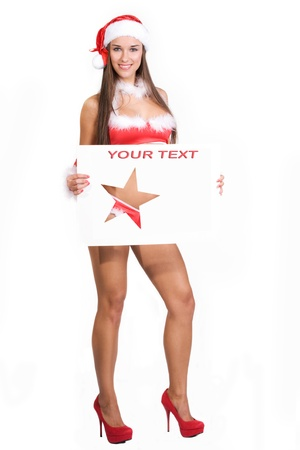 very sexy christmas girl holding empty white board in her hands on wich you can write your text on Stock Photo - 11277339