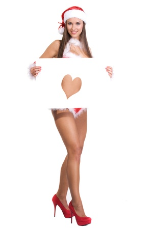 very sexy christmas girl holding empty white board in her hands on wich you can write your text on Stock Photo - 11277337