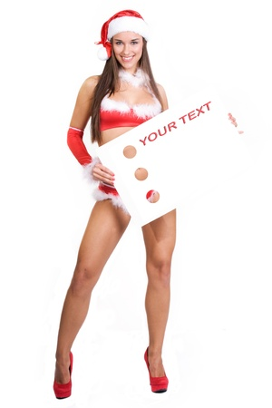 very sexy christmas girl holding empty white board in her hands on were you can write your text on Stock Photo - 11277343