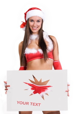 very sexy christmas girl holding empty white board in her hands on were you can write your text on Stock Photo - 11277346
