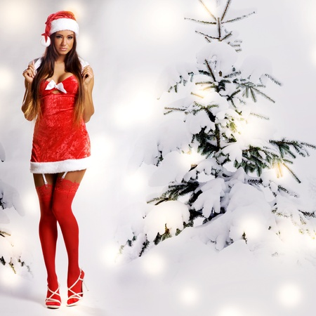 sexy christmas girl with snow background and tree Stock Photo - 11478473