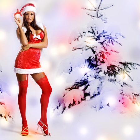 sexy christmas girl with snow background and tree Stock Photo - 11478475