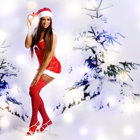 sexy christmas girl with snow background and tree Stock Photo - 11478477
