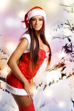 sexy christmas girl with snow background and tree Stock Photo - 11478471