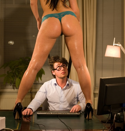 Very beautiful and sexy secretary dressed only in lingerie is working late with her manager at the office or maybe you see another story here Stock Photo - 11927786