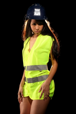 safety vest: Very beautiful and sexy working woman wearing a safety or security jacket and a helmet Stock Photo