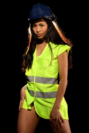 Very beautiful and sexy working woman wearing a safety or security jacket and a helmet Stock Photo - 13649168