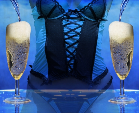 sexy woman in lingerie at a champagne celebration party pooring champagne photo