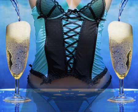 anniversary sexy: sexy woman in lingerie at a champagne celebration party pooring champagne