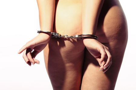 sexy woman tied with handcuffs behind her back showing her beautiful ass Stock Photo - 14003073