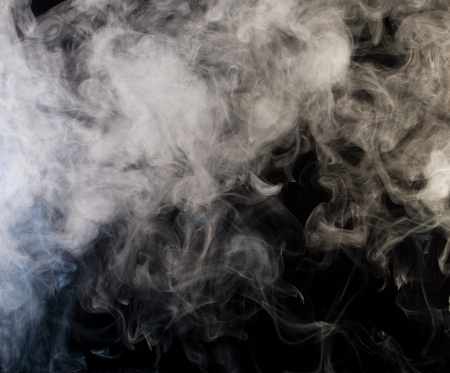 grey smoke on a black background