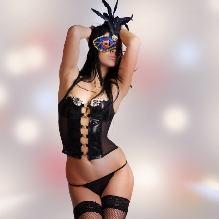 kinky woman with mask and black lingerie Stock Photo