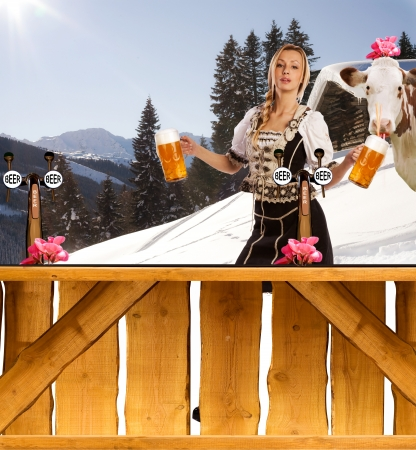 funny image in the winter snow with a very sexy woman in traditional waitress clothes  serving beer in the mountains and behind her a crazy cow Stock Photo - 14429077