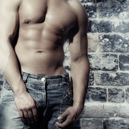 artwork male with a sexy man without a shirt standing against a wall