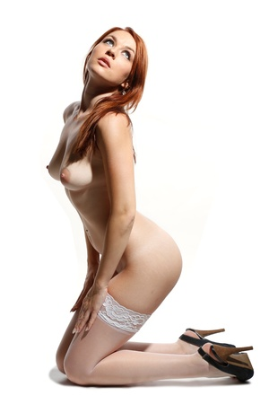 topless brunette: sexy nude woman with red hair and white stockings on white background