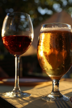 wine background: drinking beer and wine at a table