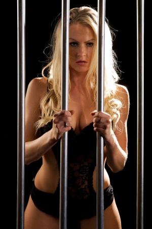 beautiful sexy woman in lingerie locked in prison cell Stock Photo - 15228413
