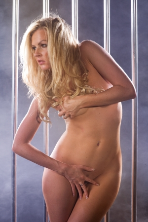 beautiful nude woman in a prison cell Stock Photo - 15228409