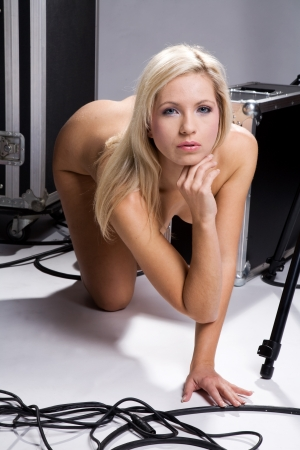 sexy and beautiful naked woman posing next to a flightcase Stock Photo - 15377618