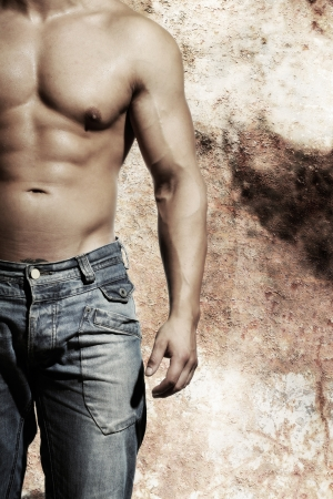 beautiful sexy man is standing infront of an uraban style old wall Stock Photo - 15570728