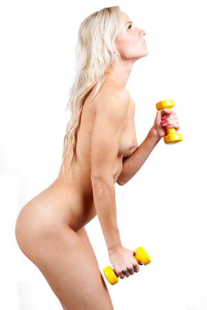 nude blonde girl: very sexy nude  woman in sports athlete style with dumbbells Stock Photo