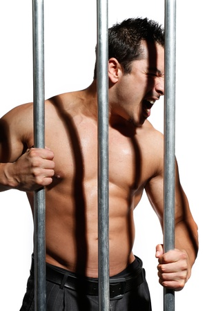 sexy shirtless man behind bars on white background Stock Photo - 16301290