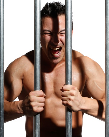 sexy shirtless man behind bars on white background Stock Photo - 16301345