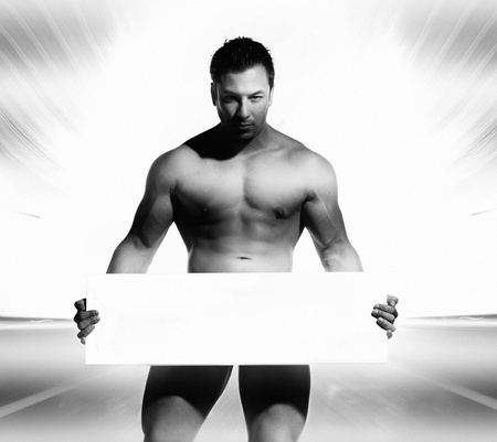 beautiful and sexy naked and well trained sports man is holding and displaying a white board in his hands on were you can write text Stock Photo - 16714791