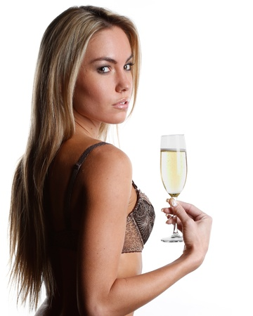 very beautiful woman dressed in sexy lingerie is drinking champagne