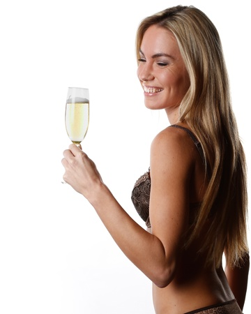 champaign: very beautiful woman dressed in sexy lingerie is drinking champagne