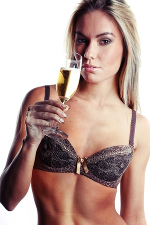 very beautiful woman dressed in sexy lingerie is drinking champagne Stock Photo - 16780532