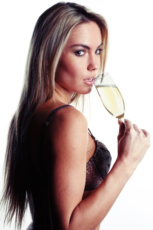 very beautiful woman dressed in sexy lingerie is drinking champagne photo
