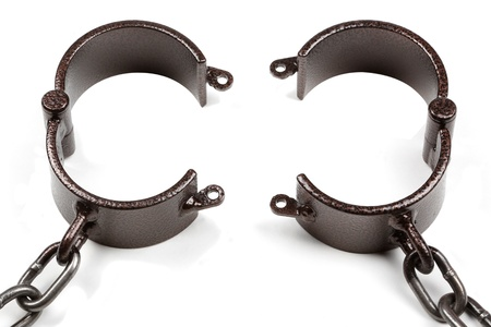 old style medieval handcuffs made of heavy iron to cuff your slave  photo