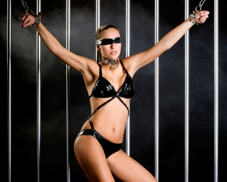 bondage style with  a very sexy woman dressed in lingerie Stock Photo - 16889726