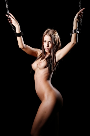 bondage art style with nude or naked woman tied up with a chain and cuffs