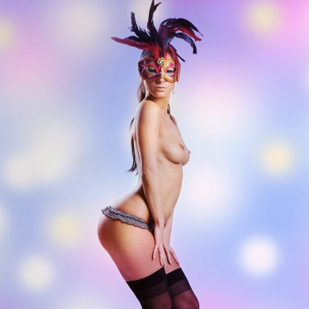 beautiful nude or naked woman with venetian facemask photo