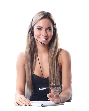 very beautiful woman with a big smile is working as a secretary in communication or business style with headset and microphone Stock Photo - 19536566