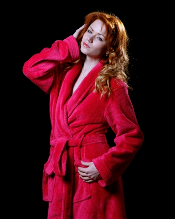 red bathrobe: very beautiful and sexy woman with flaming red hair is dressed only in a bathrobe