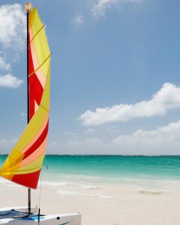 beautiful caribbean sea with a colorful sailing boat photo