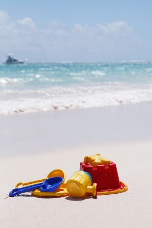 kids playing toys are laying at the beach photo