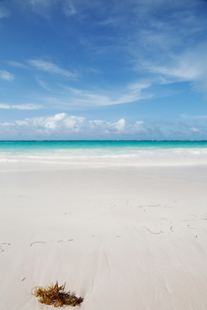 very beautiful blue ocean and white sand background with on the horizon dark clouds photo