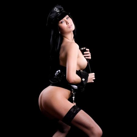 femme nue: sexy femme nue ou nue fait un strip v�tements de s�curit� de la police ou
