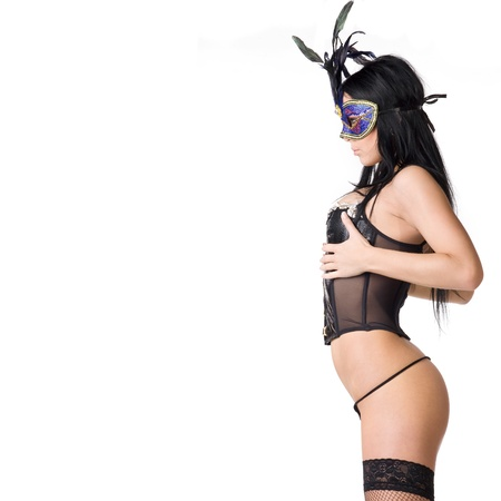 facemask: beautiful woman in sexy gothic or kinky black lingerie with a mysterious venetian facemask covering her face made in studio on a white background
