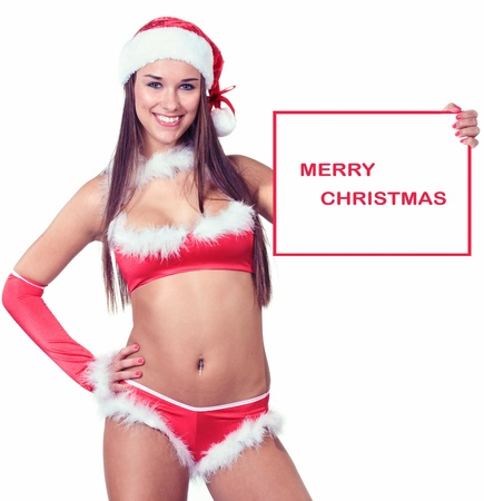 very sexy christmas woman holding empty white board or billboard in her hands on were you can write your text on photo