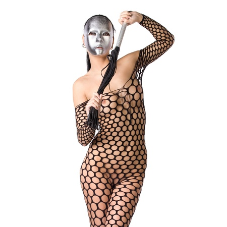 naked black women: beautiful nude or naked woman dressed only in fishnet stocking or dress and she is holding a whip in her hands and her face is covered with a kinky scary mask or facemask on a white background