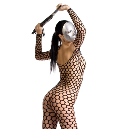 naked black woman: beautiful nude or naked woman dressed only in fishnet stocking or dress and she is holding a whip in her hands and her face is covered with a kinky scary mask or facemask on a white background