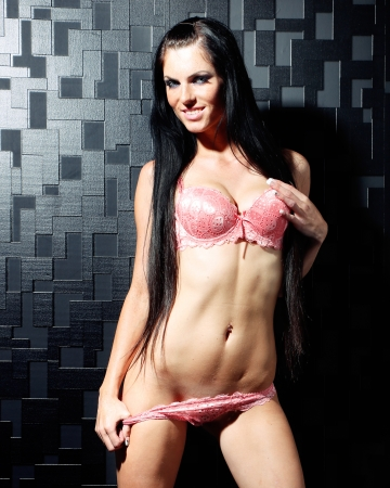 beautiful caucasian white woman with dark hair in sexy pink lingerie photo