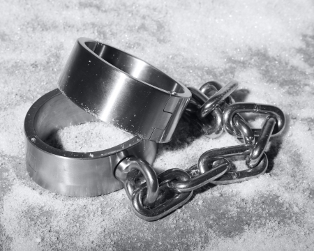 bdsm handcuff: hard steal or iron handcuffs or cuff laying in the snow